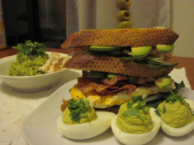deviled eggs, a voyager sandwich, and guac.