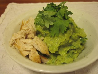 garnished with cilandro and shredded chicken.